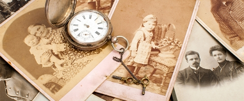 Aged photograph and pocket watch
