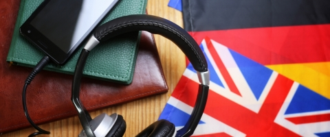 Image of headphones and international flags